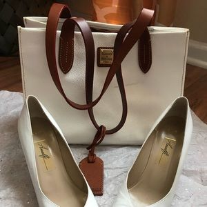 Dooney & Bourke Tote.  White with brown straps.